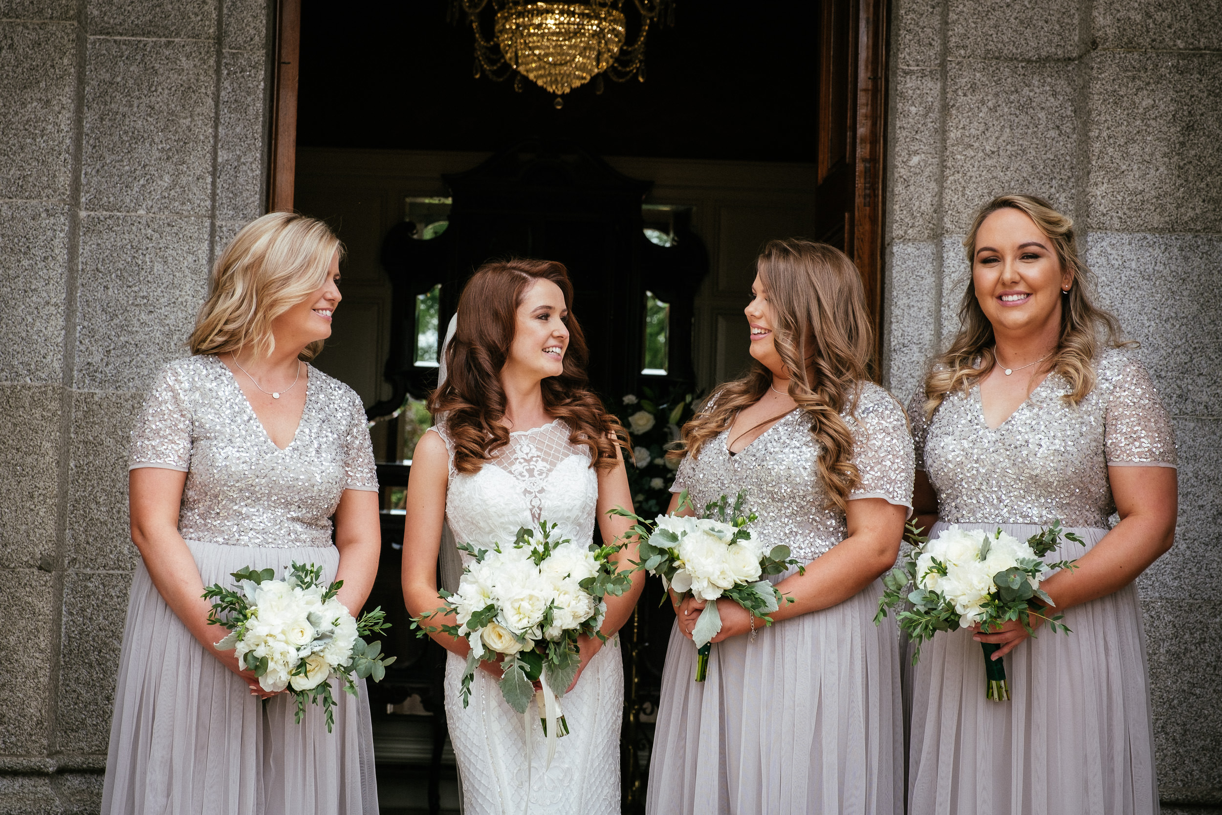 bride and bridesmaids at front door to killashee house hotel