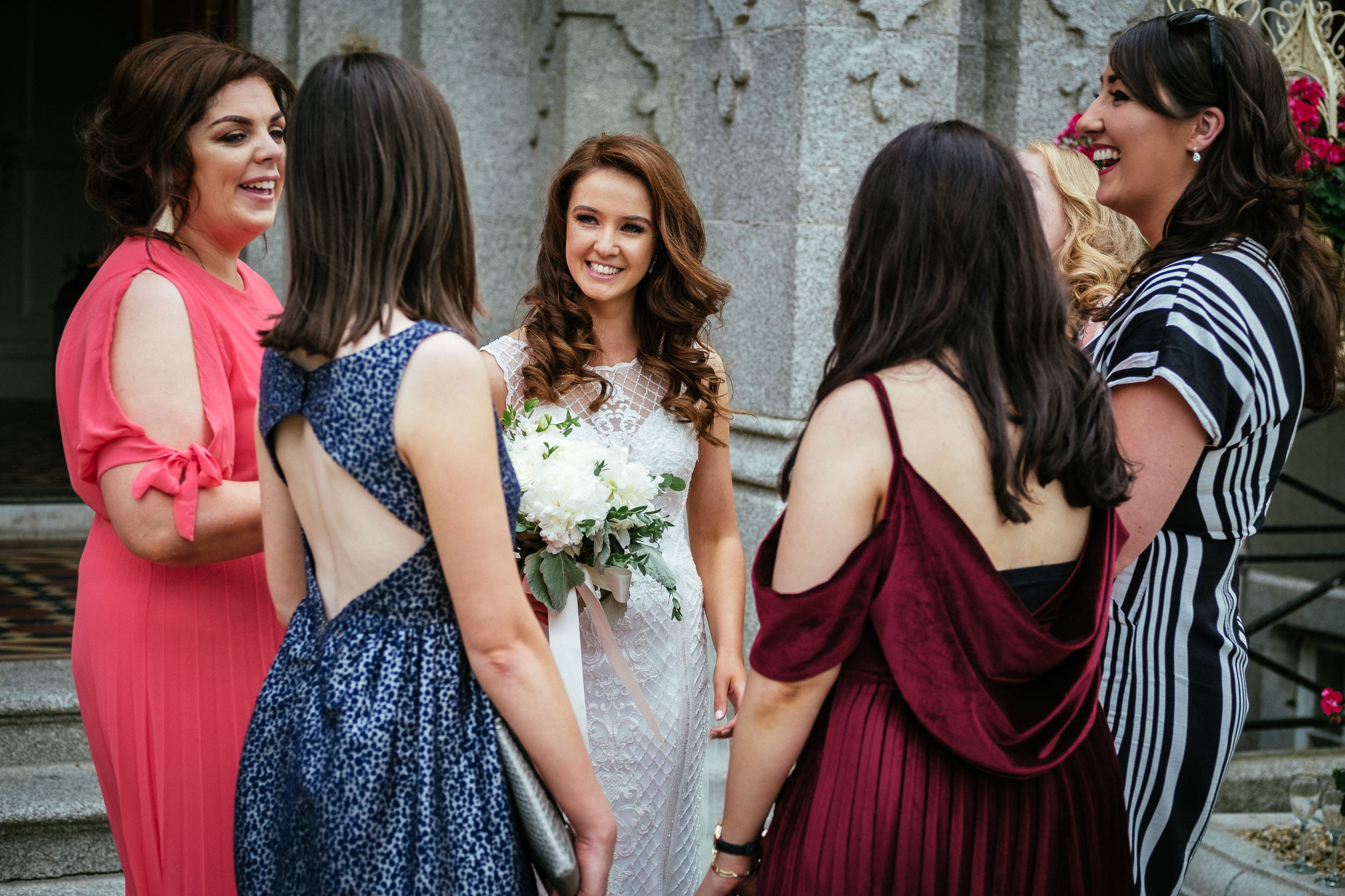 bride laughing with guests at killashee house hotel wedding