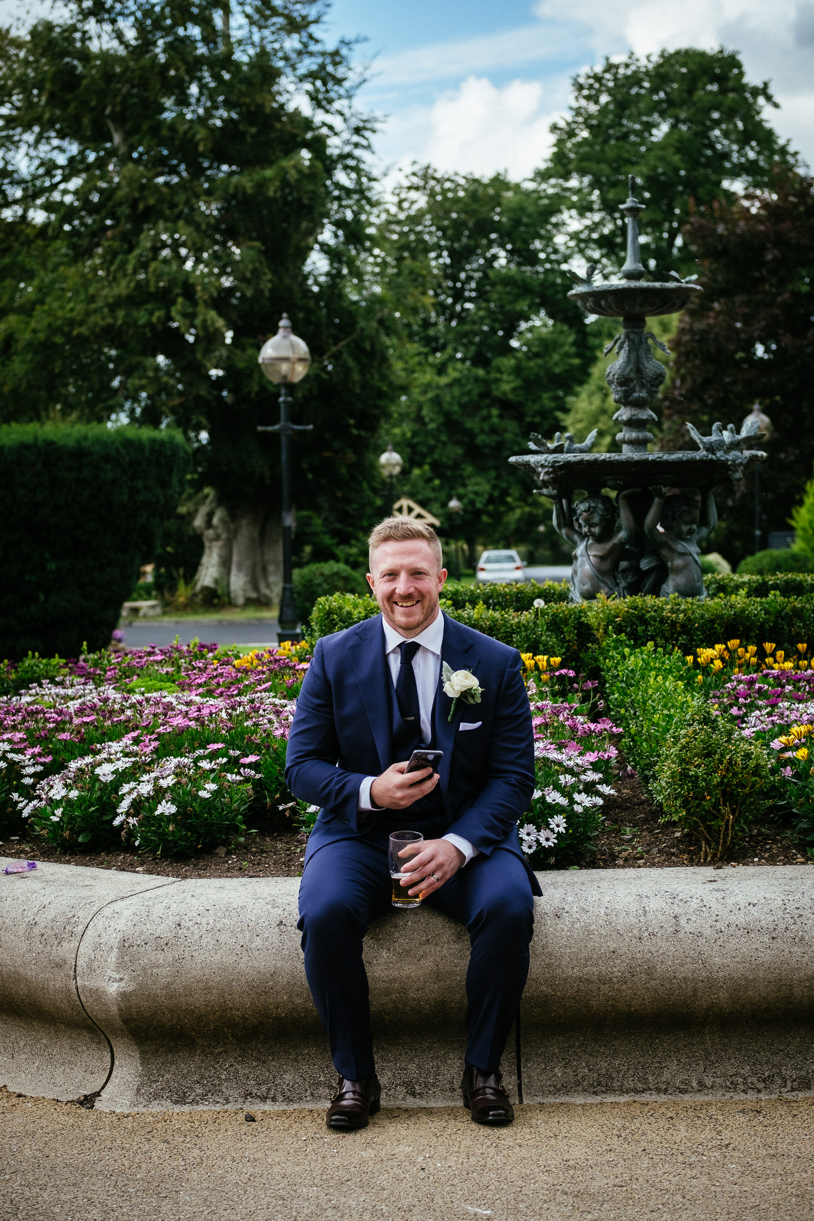 groom laughing at camera at his killashee house hotel wedding