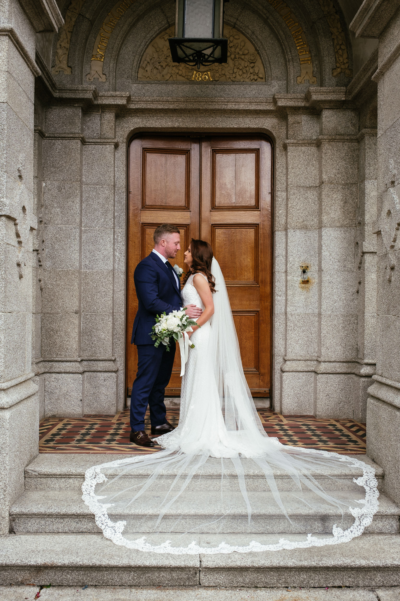 bride and groom posing for a photo at door of killashee house hotel