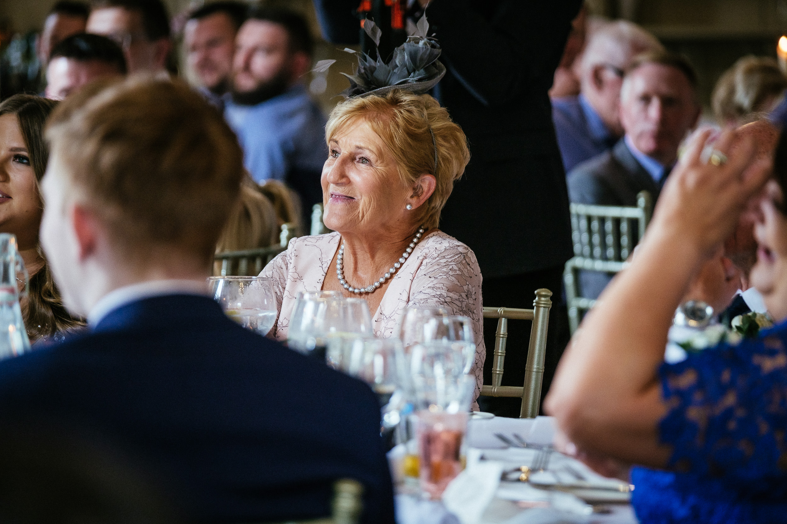mother of bride smiling during speeches at killashee house hotel wedding