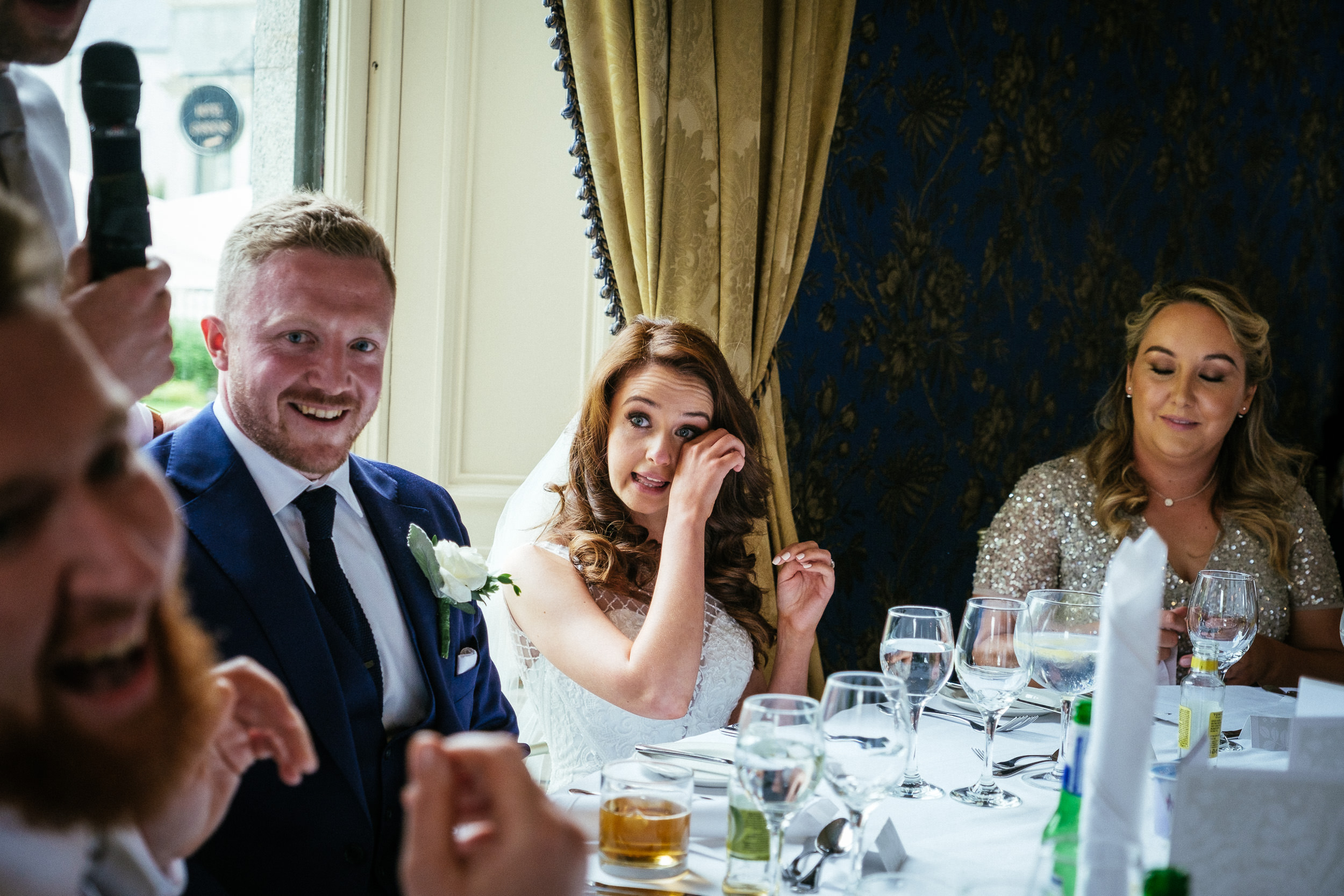 bride wiping a tear from her eye at killashee house hotel wedding