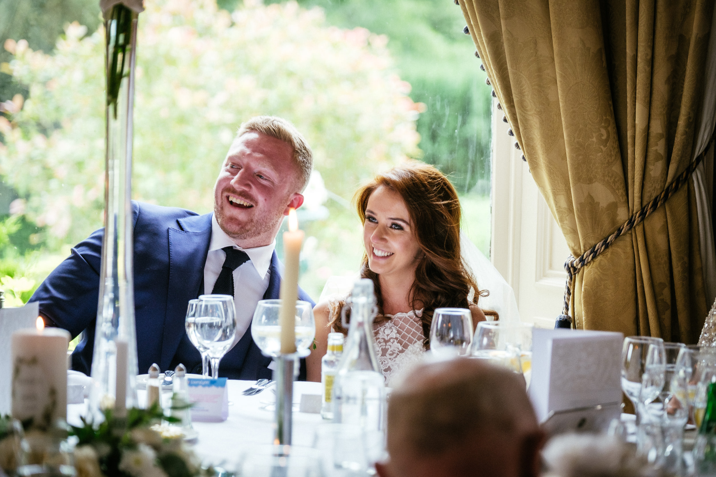 bride and groom laughing during speeches at killashee house hotel wedding