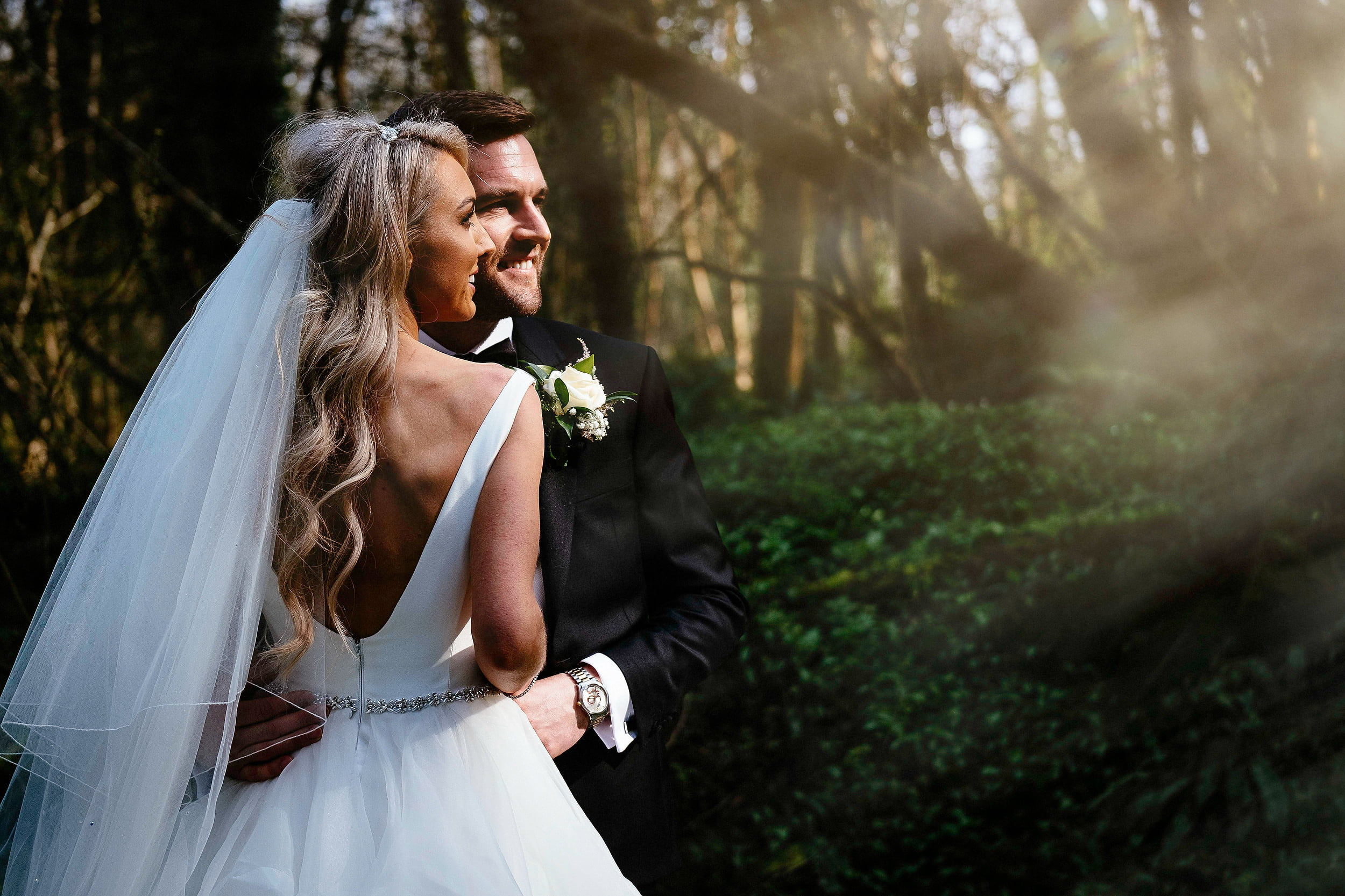 bride and groom staring into the sunset at at the Summerhill House Hotel