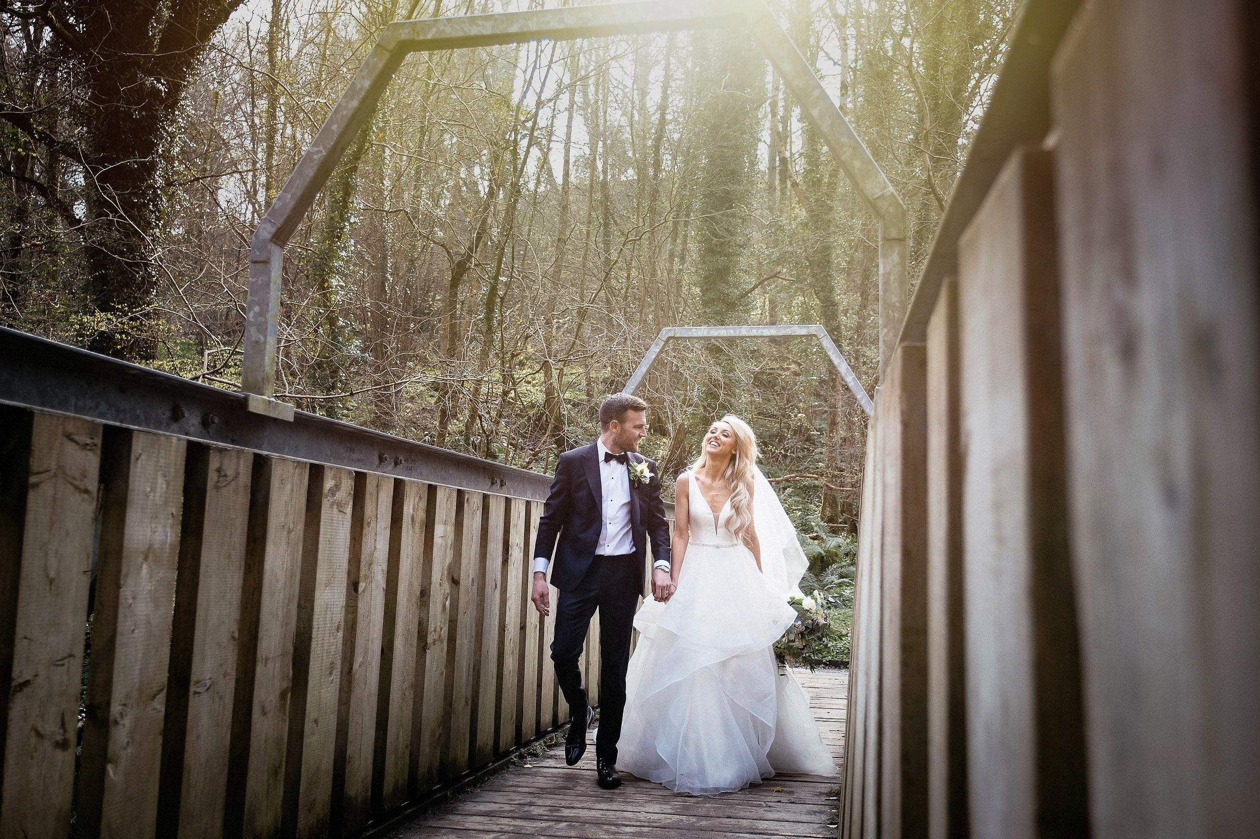 bride and groom crossing a bridge in Enniskerry