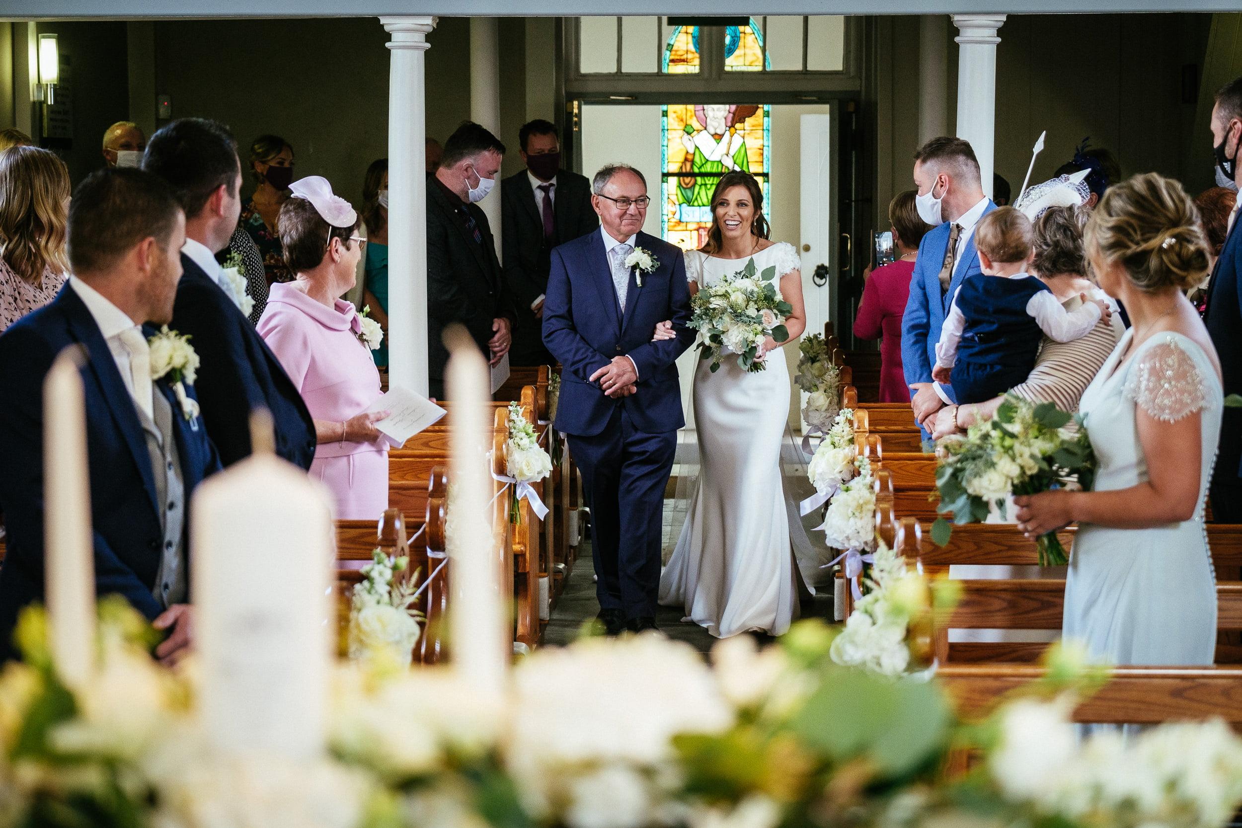 bride walking up the aisle at St. Patrick's Church, Kilquade