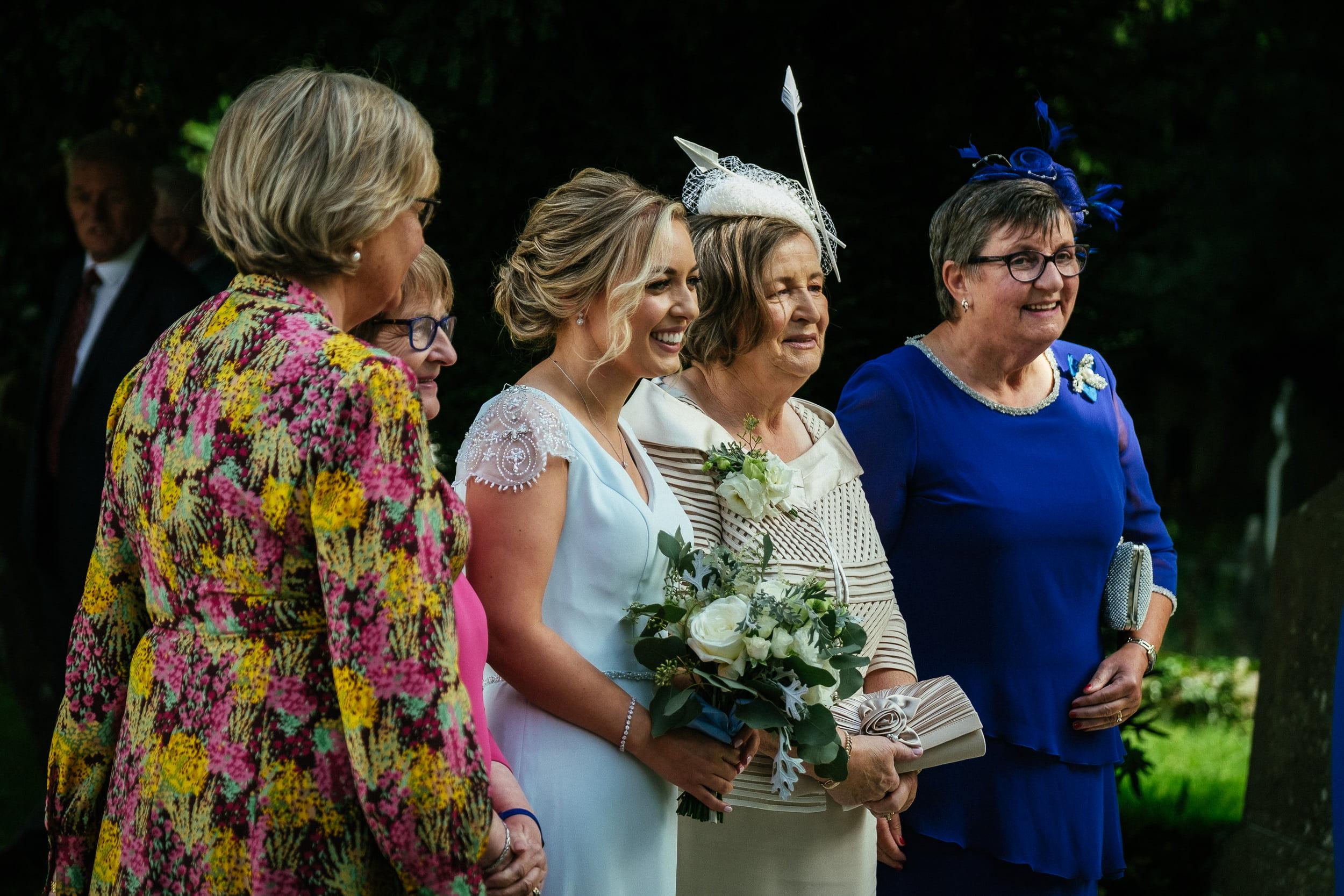 bridesmaid laughing at St. Patrick's Church, Kilquade