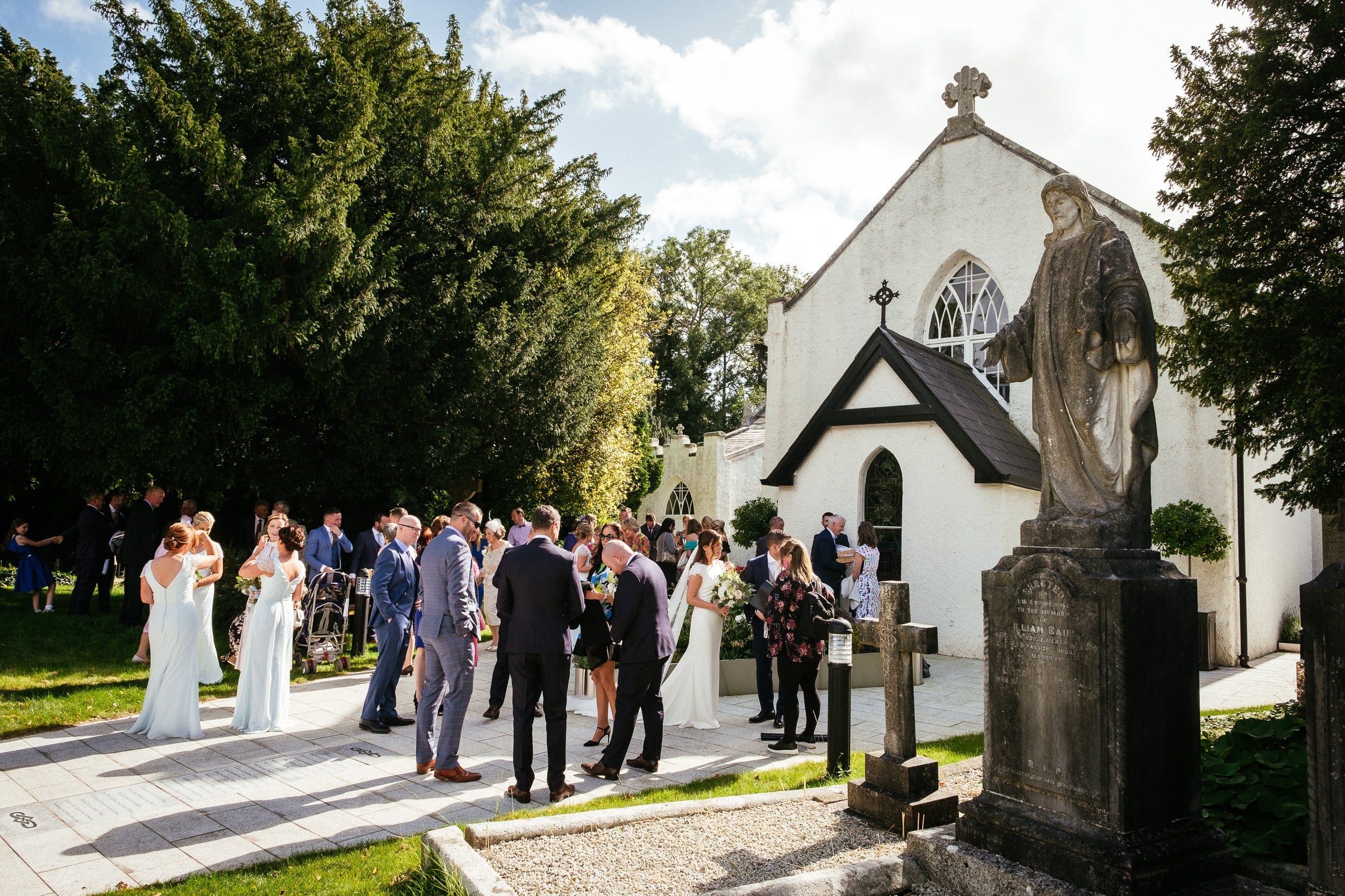 wedding guests outside St. Patrick's Church, Kilquade