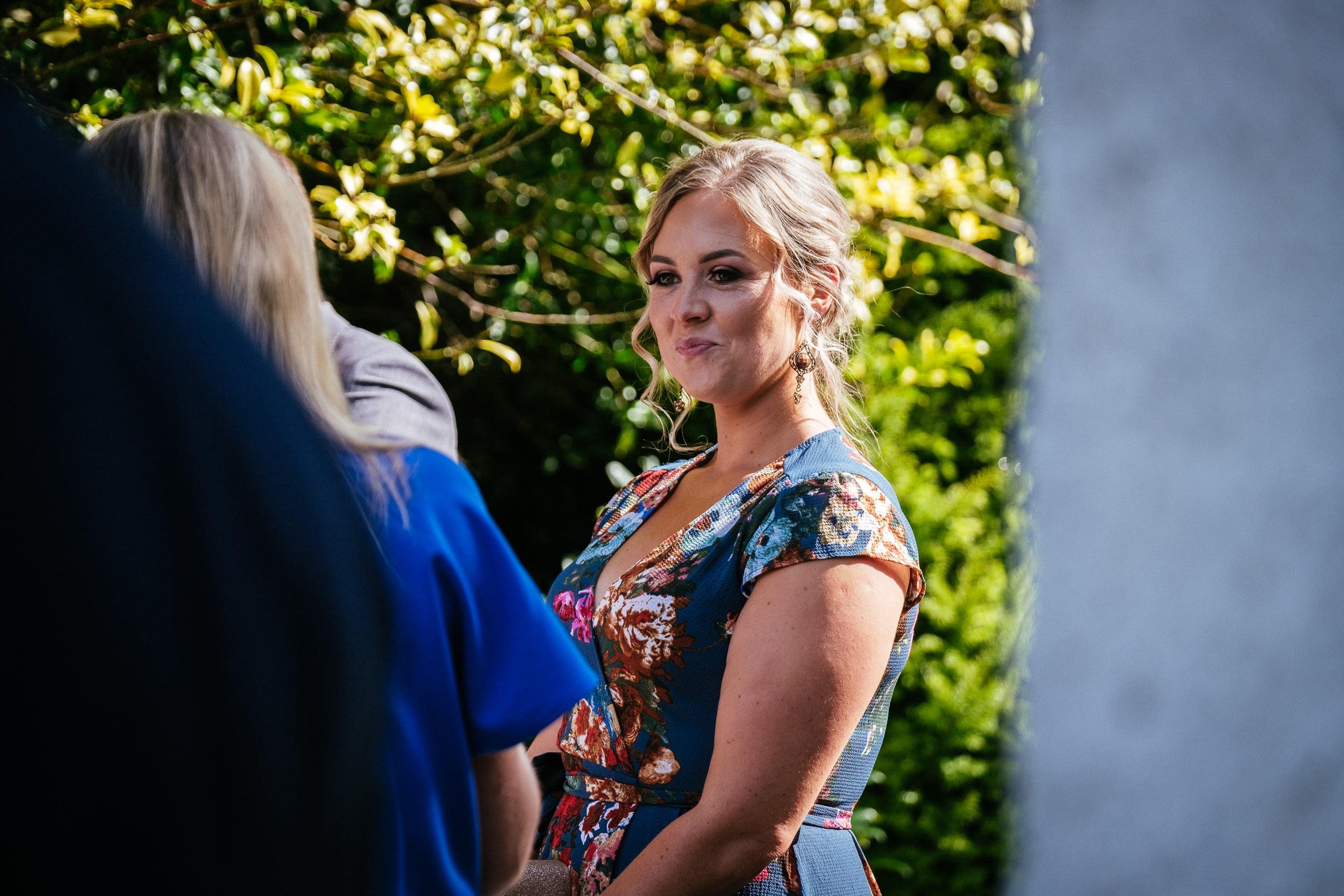 female wedding guest outside St. Patrick's Church, Kilquade