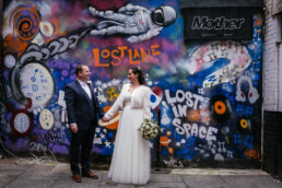 bride and groom looking at eachother on grafton street before their City Hall Wedding Dublin