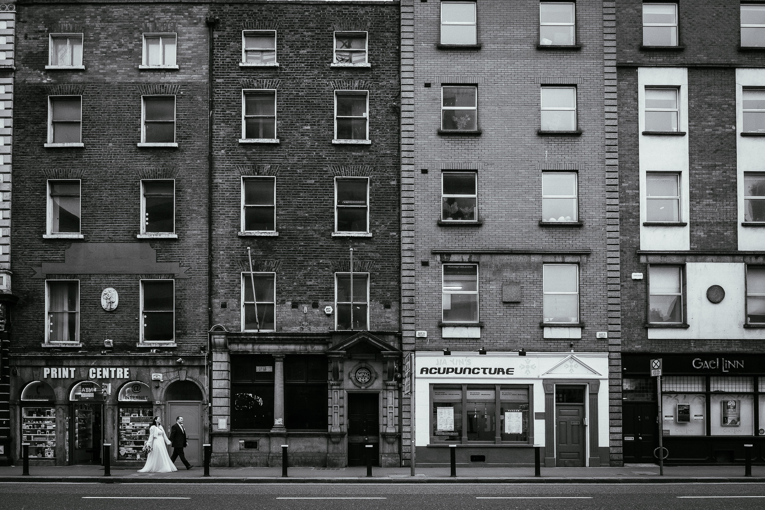 bride and groom walking down Dame Street to their City Hall Dublin wedding