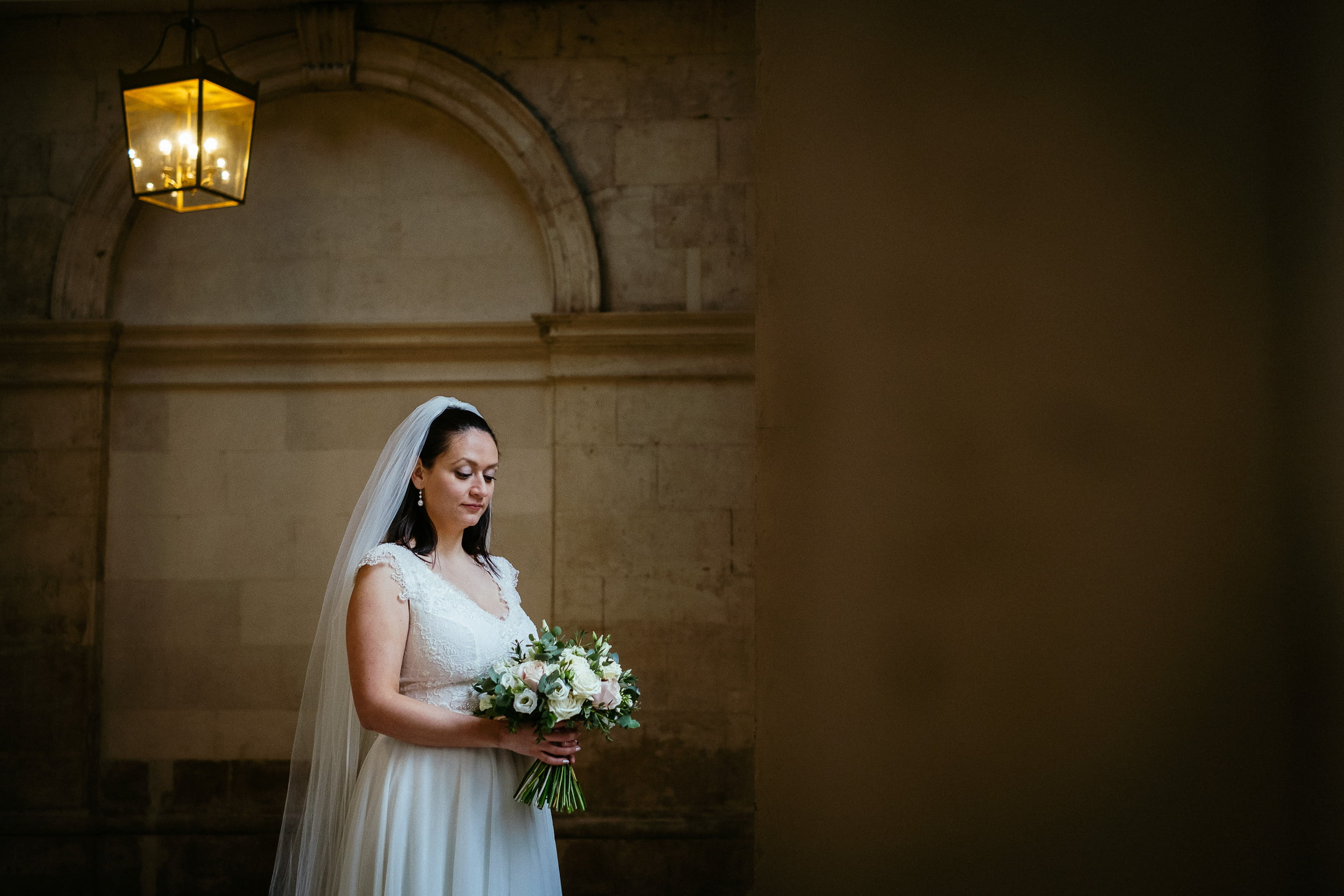 bride holding flowers at her wedding in city hall dublin