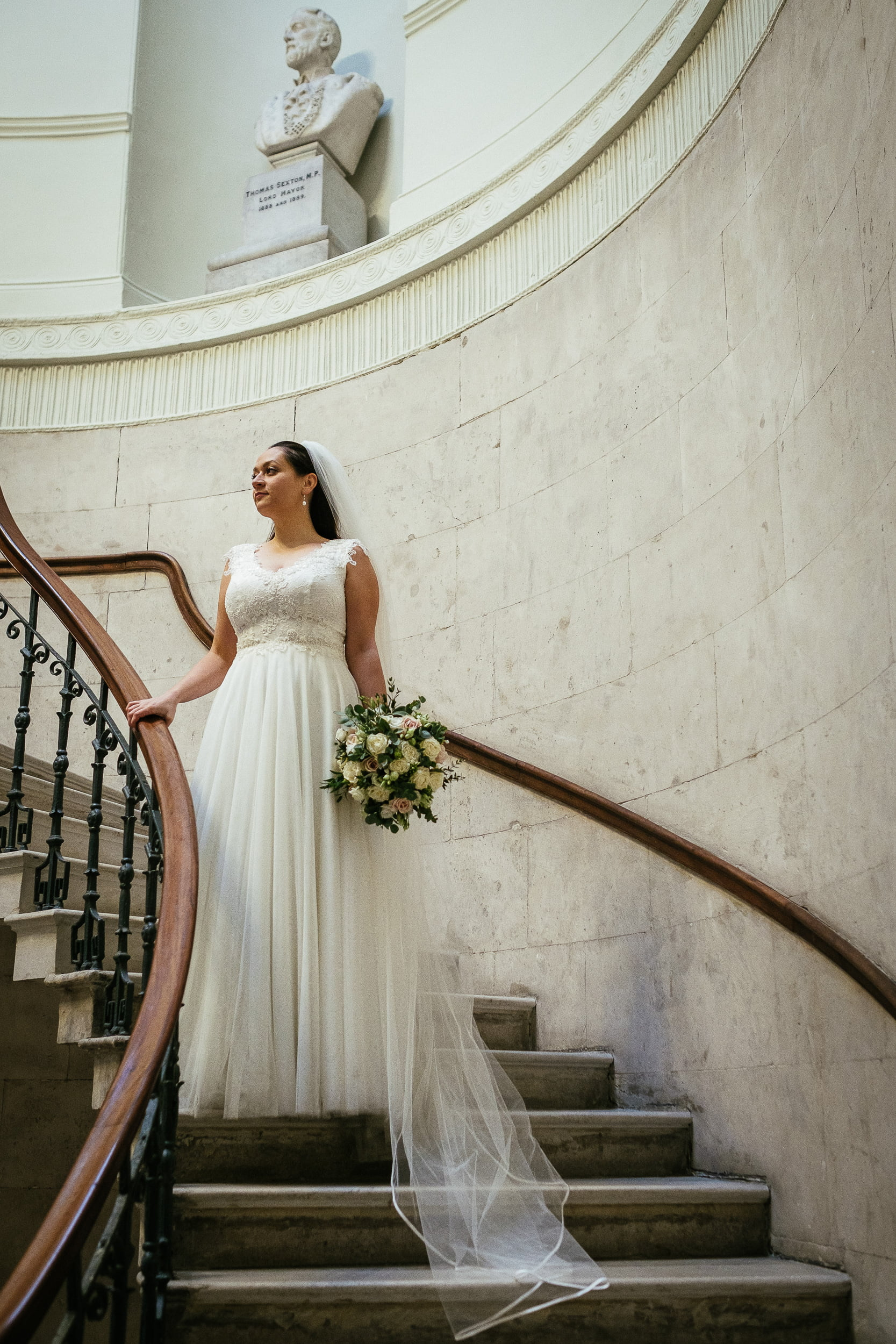 bride on the steps in city hall dublin