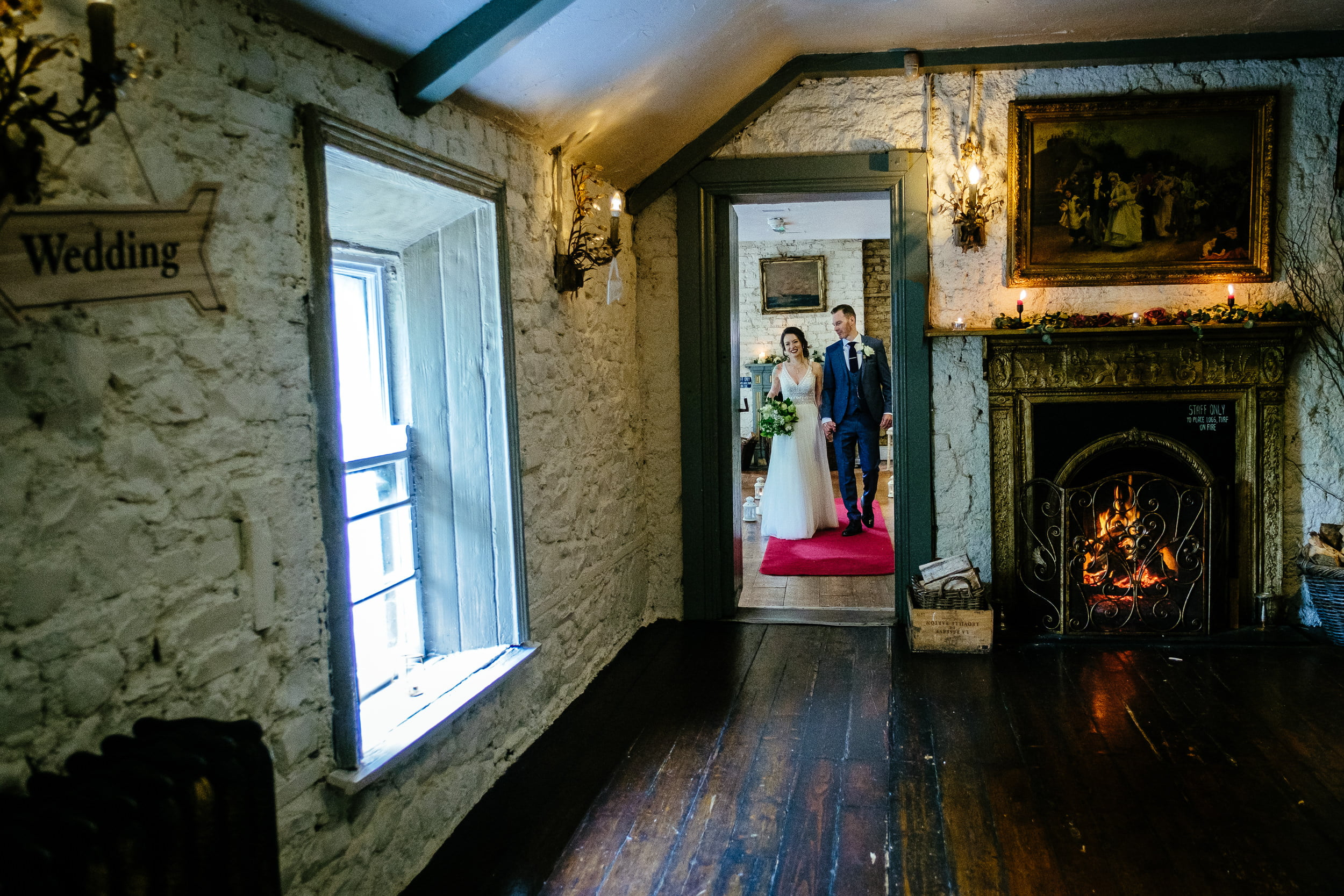 bride and groom walking out from their ceremony in anglers rest dublin
