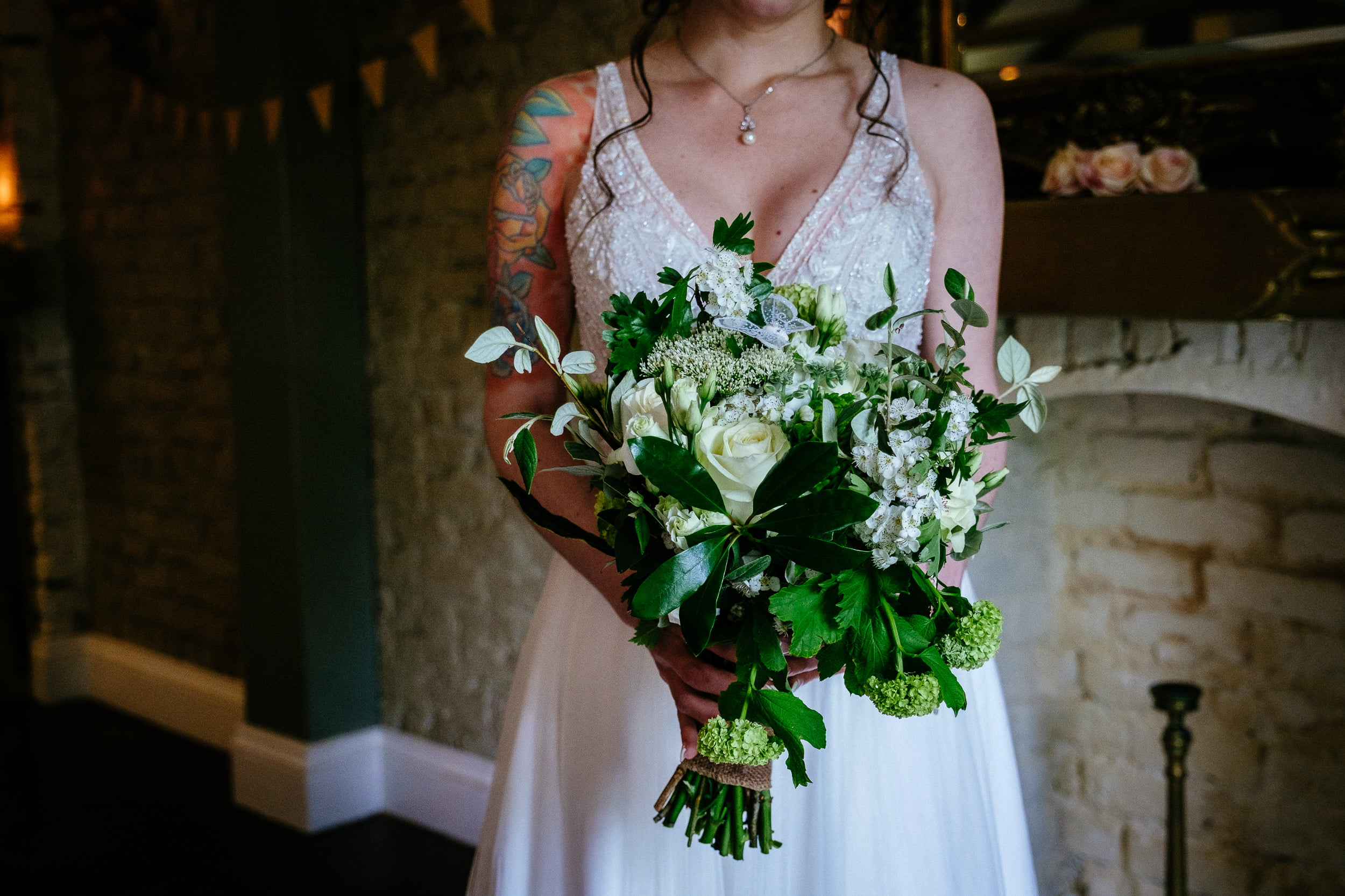 bride holding flowers in anglers rest dublin