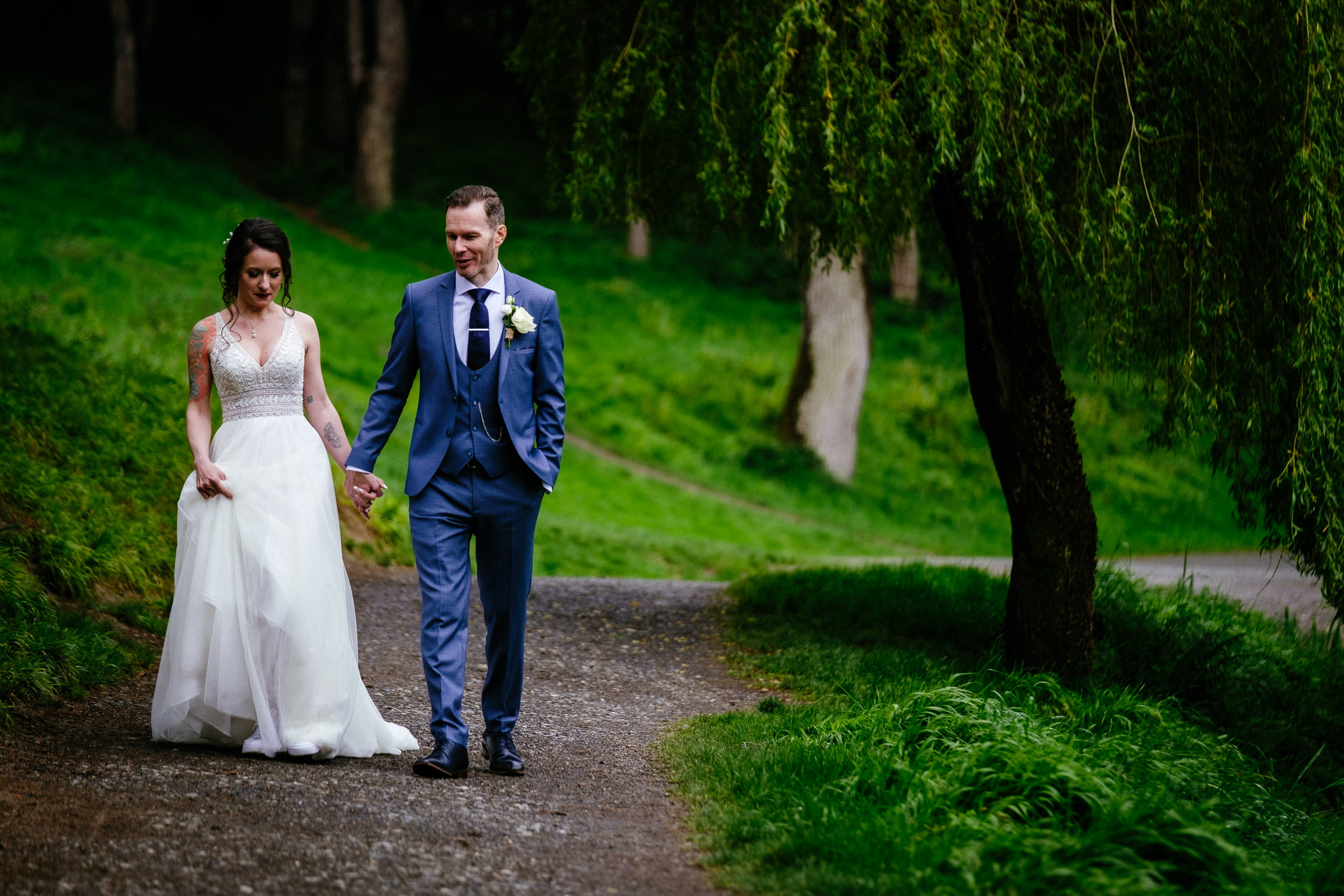 bride and groom walking through the phoenix park in dublin