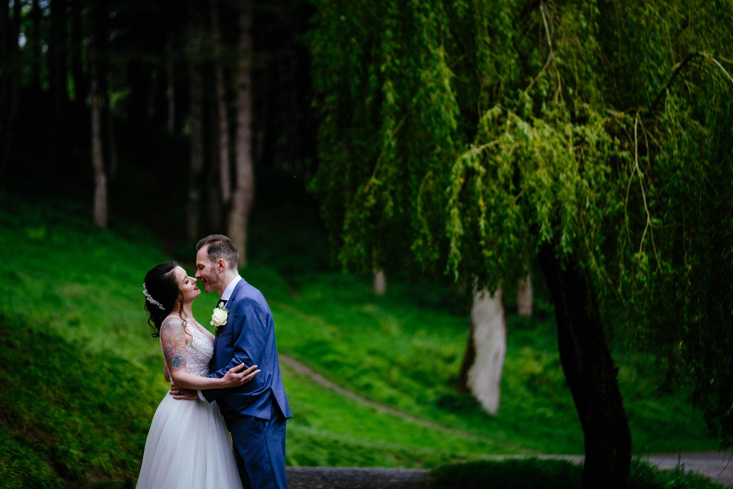 bride and groom walking through the furry glen in the phoenix park in dublin